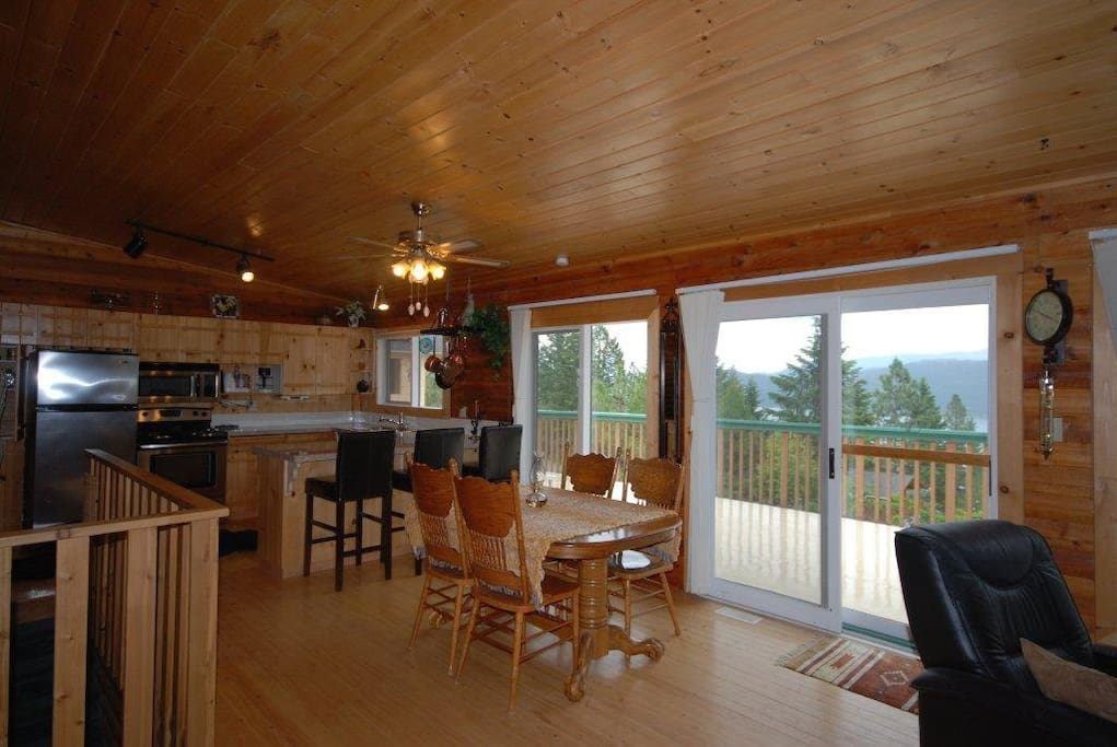 View from livingroom into kitchen with granite counters and stainless steel appliances.