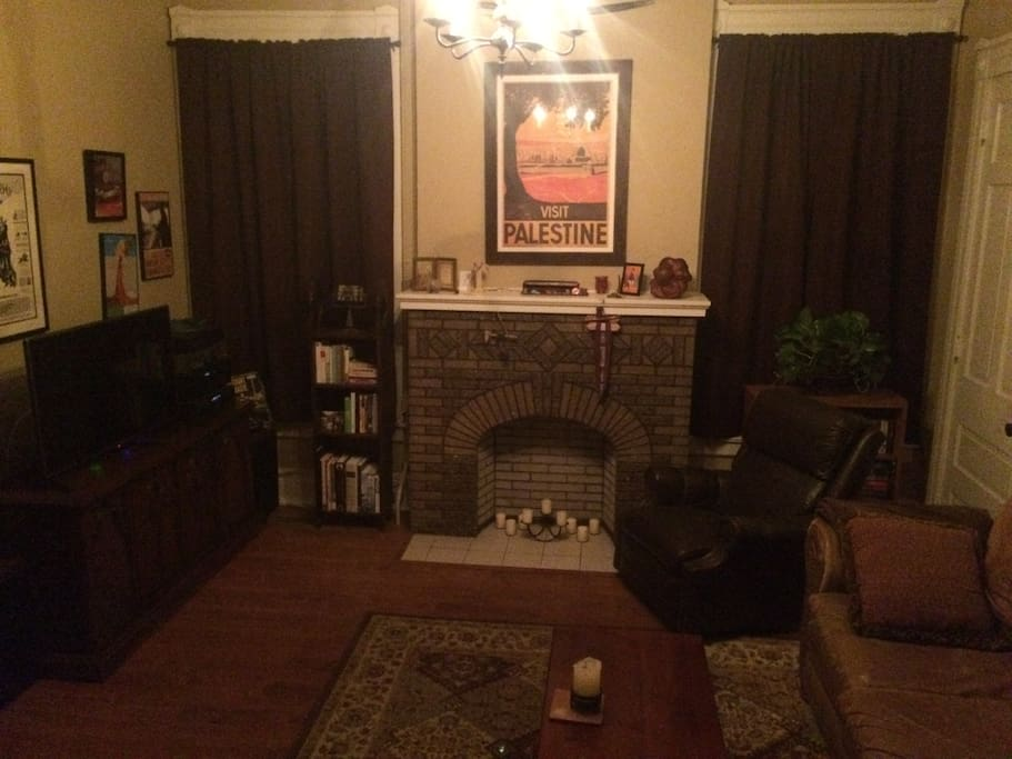 Comfy living room with stereo and hipster cable.