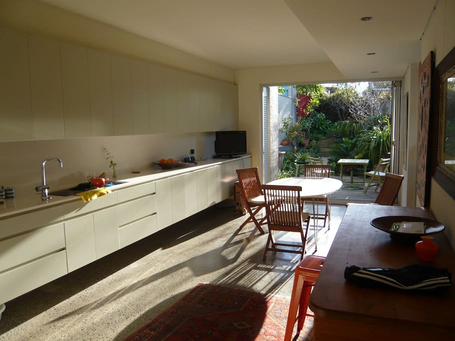 Winter afternoon sun streams into the Kitchen/Dining area which opens onto the private rear garden.