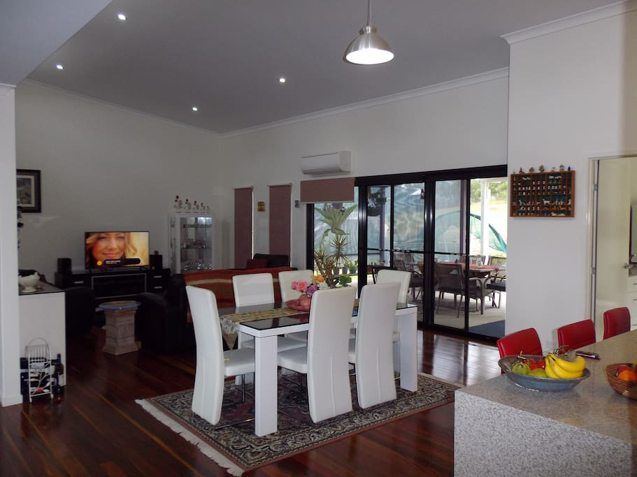 Large kitchen, dining and living area with easy access to outdoor facilities.