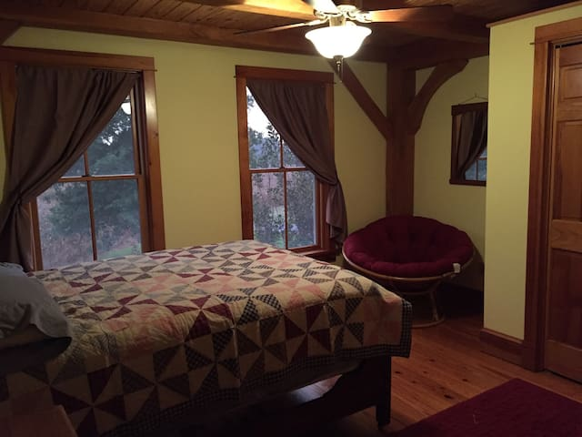The full size bed in this upstairs bedroom is across the hall from the bathroom with tub and shower. The bedroom next door has a queen sized bed with an extra twin mattress underneath that can easily allow room for another guest.