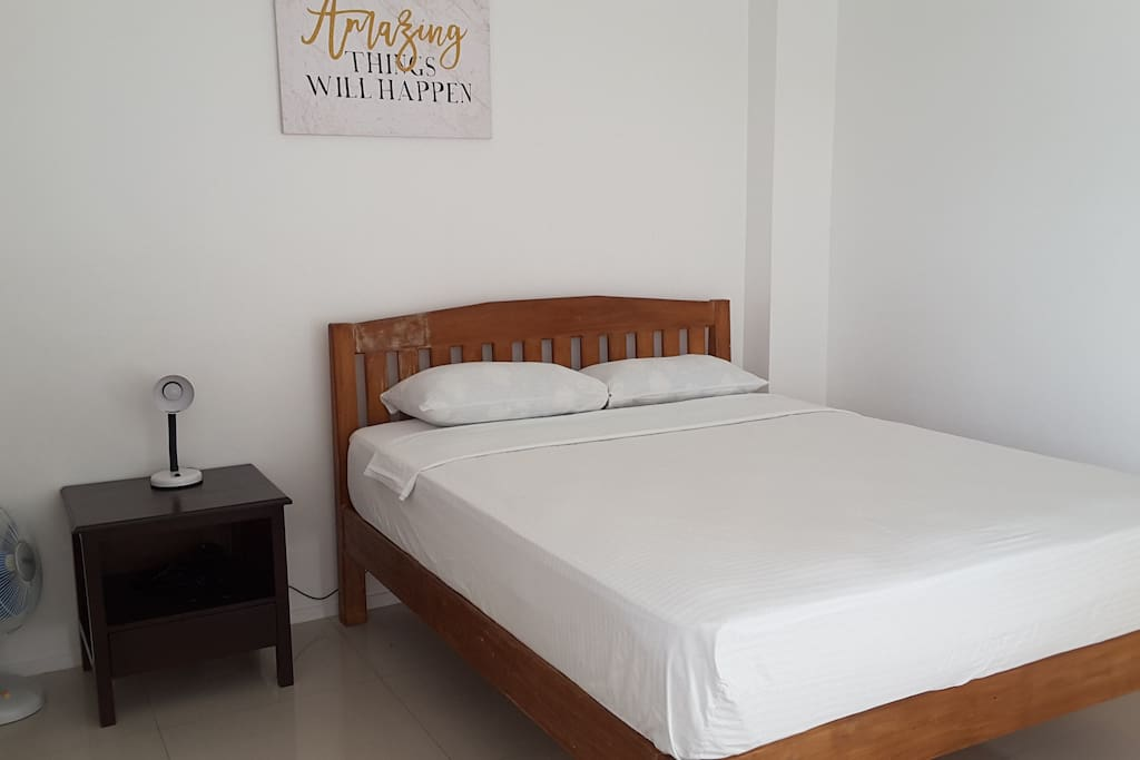 Queen side bed with electric fan