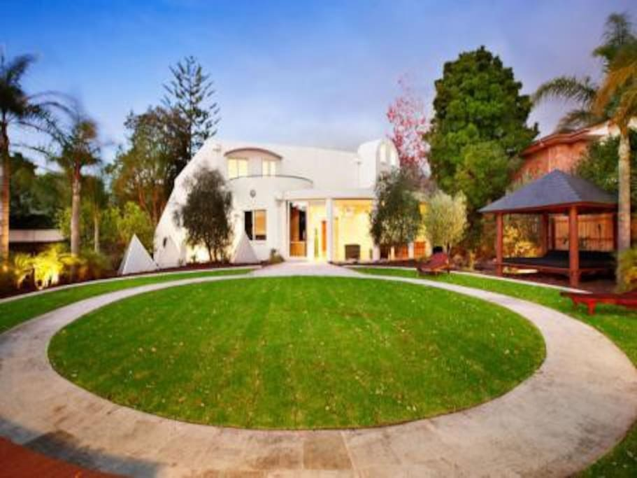 Expansive rear yard with relaxing daybed