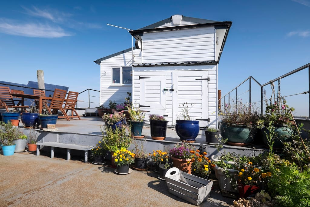 Guests have access to the outside deck with a fire pit, chimnea and a gas BBQ .