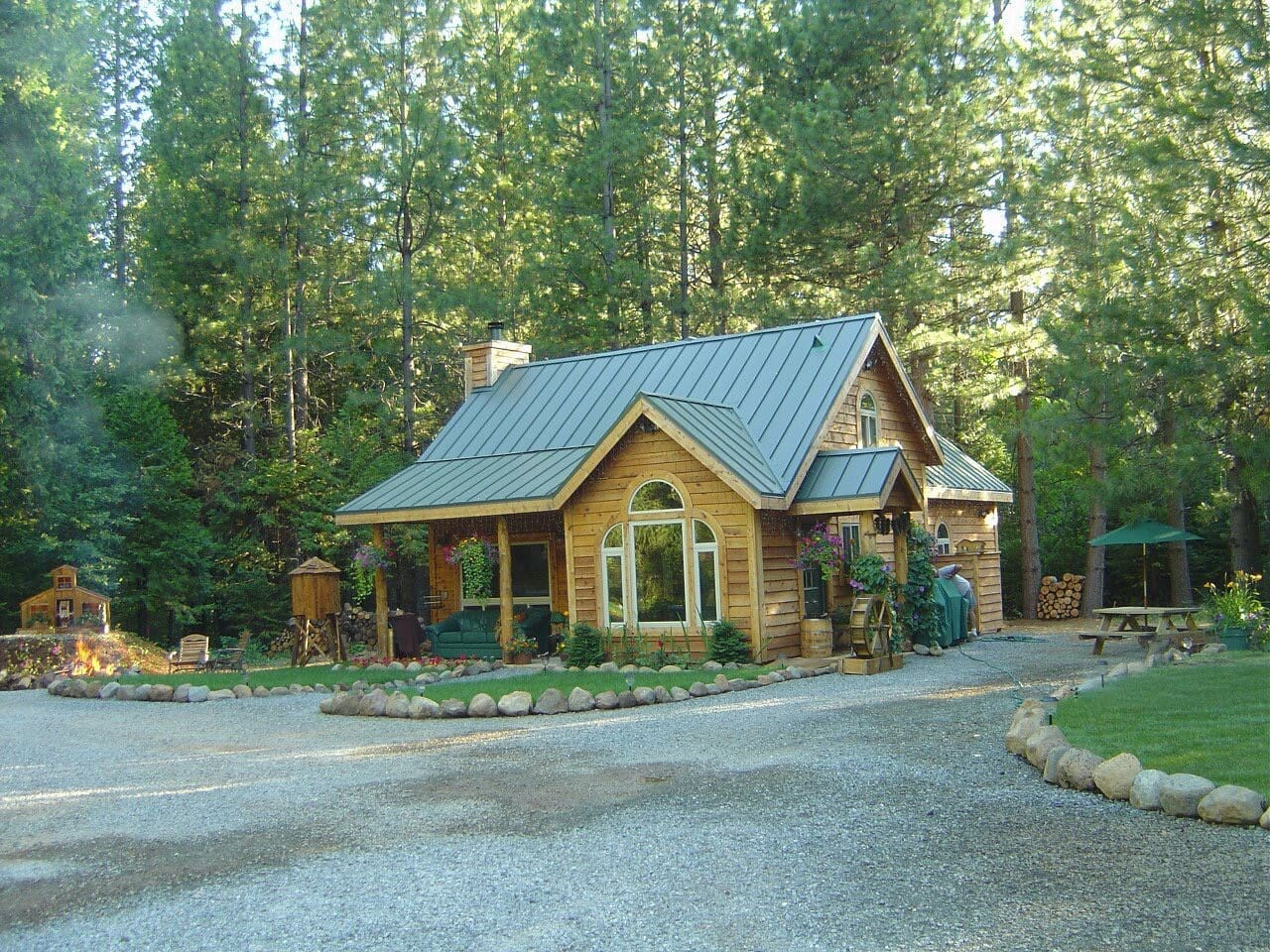 A small acreage with fire pit, trails, a disc golf course and forest loveliness to explore.