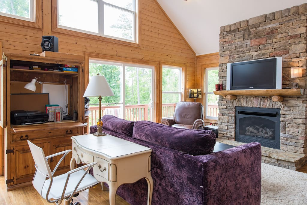 The main living area is wonderfully enhanced by natural light from numerous windows and sliding glass doors to the deck.