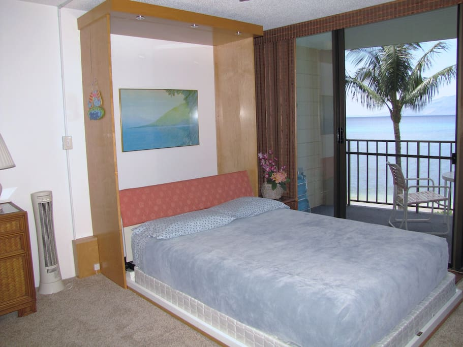 Queen Murphy bed ready for a comfortable night's sleep.  Fall asleep to the sound of the waves.