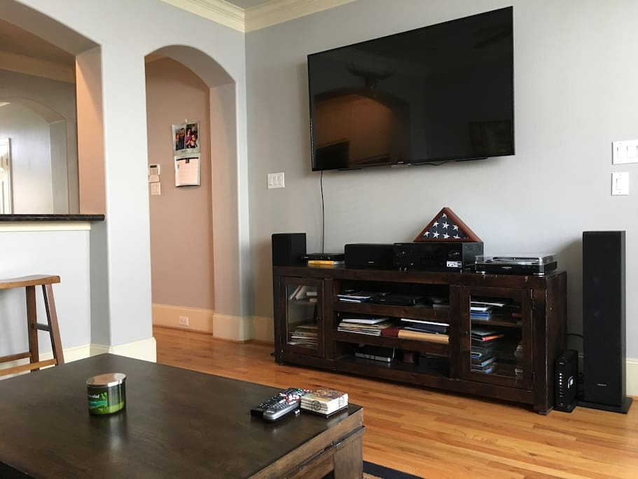 Living Room Features 65-inch TV, basic cable, record player, and surround sound system