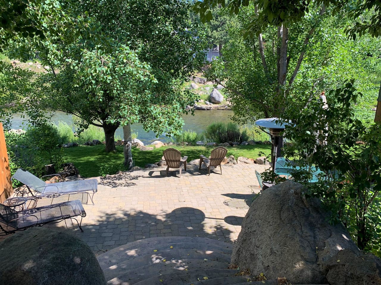 You could be sitting here!  Large backyard patio right outside your door and right on your private 80 feet along the Truckee River.  Walk to everything in downtown Truckee, yet feel away from it all when at home.