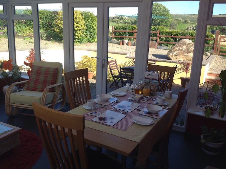 Table set for 2 in the conservatory - the countryside almost steps in the door
