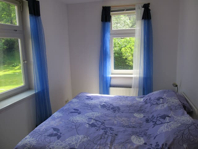 Bright bedroom with deluxe pocket springs mattress.