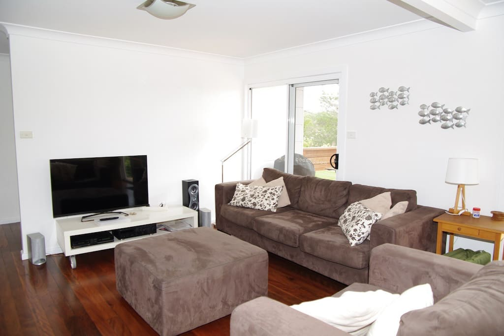 Enjoy the comfortable living room with TV, DVD player  and hifi system