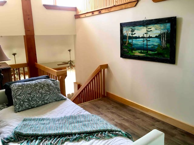 Comfy trundle bed for extra guests. This bed is located in a roomy landing at the top of the stairs.