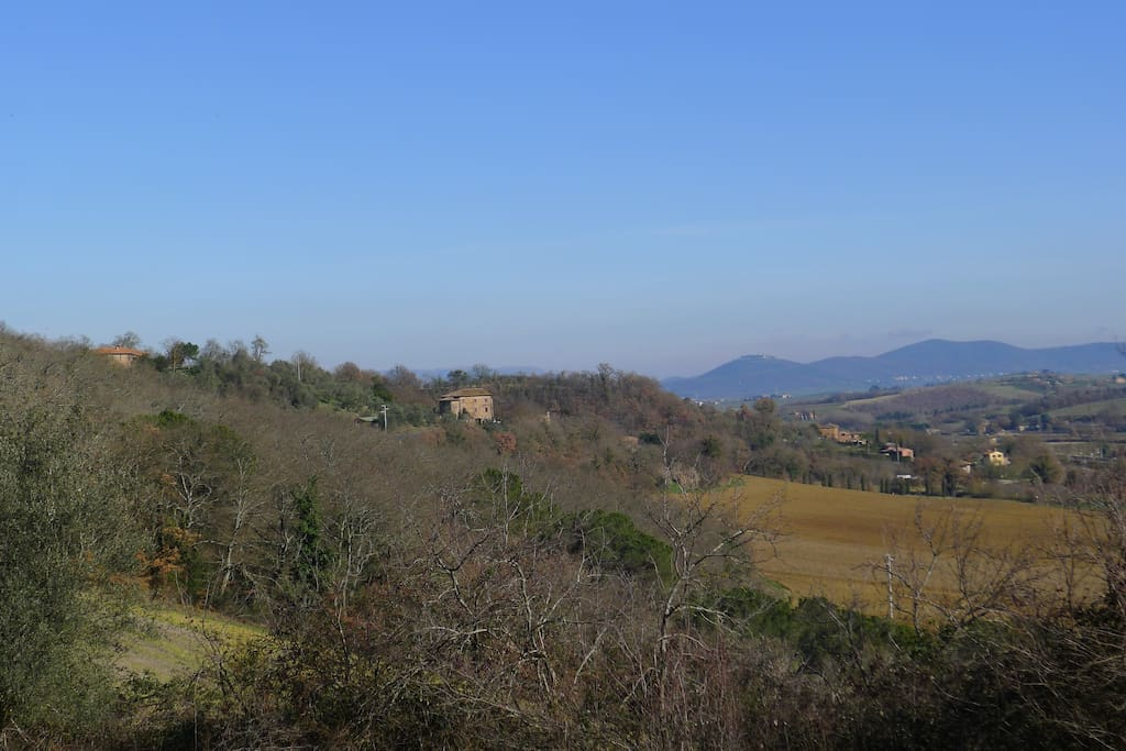Our house looking to the winter sun. This photo looks northeast up the Val di Tresa toward Lago Trasimeno.