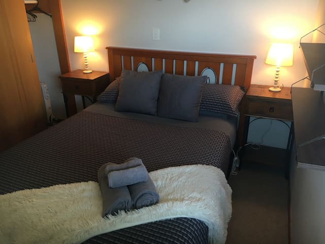 Queen size bed with heated blanket