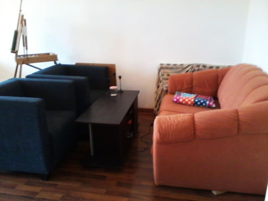 couch corner with two armchairs and a table