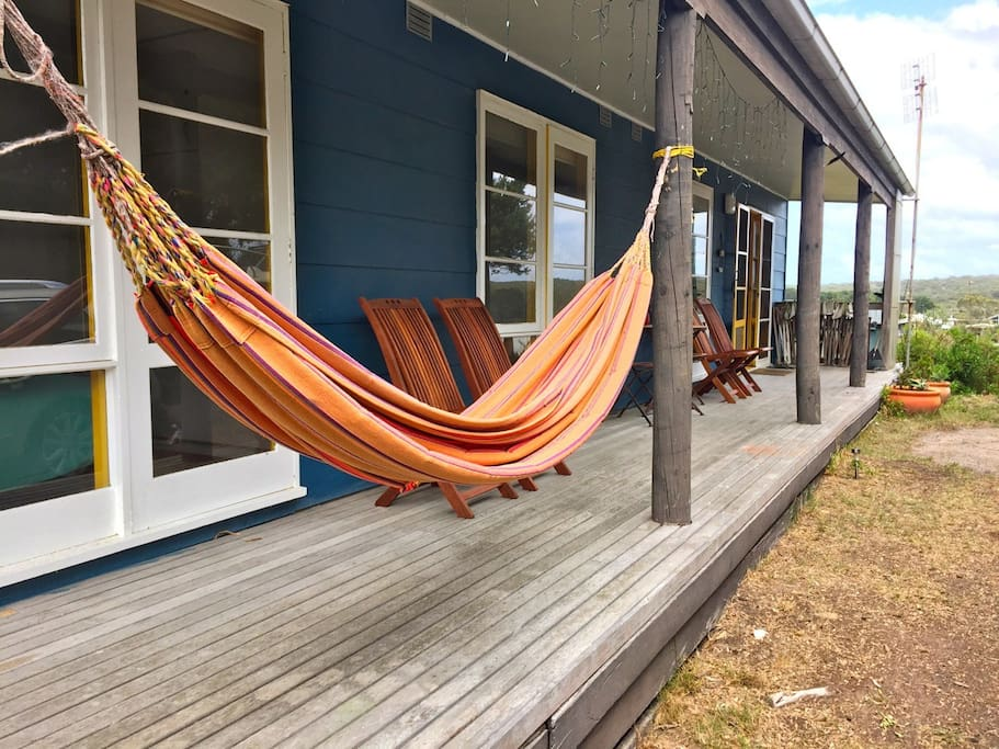 Shady chill-out deck with hammock.