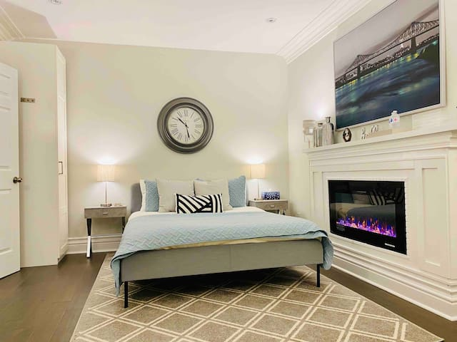 Queen bedroom on the main floor with fireplace, spacious, welcoming and comfortable.