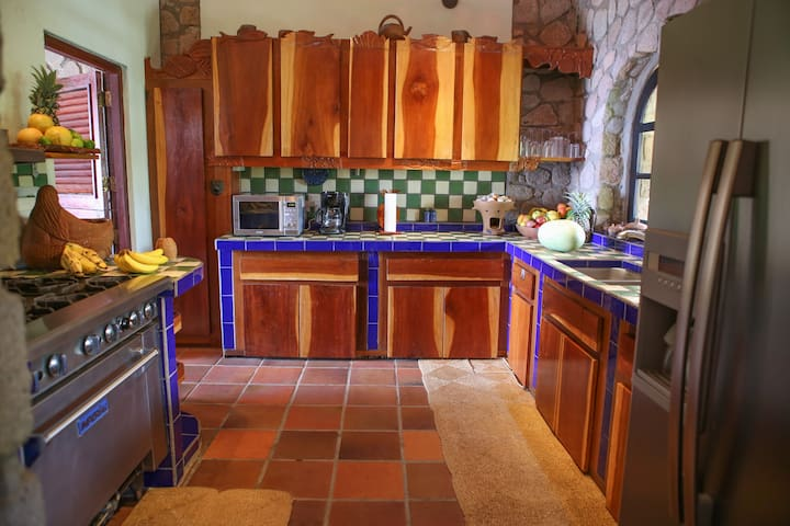 The artful kitchen with industrial stove and ice maker refrigerator makes every day a food fantasy.