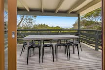 """The view from the balcony is stunning, and the house it self its well located being walk distance from 2 beaches."" Carole, May 2016. North facing deck with outdoor dining table - amazing views and scenery from every seat."