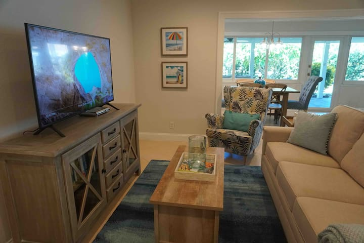 The living room has a flat screen smart tv, three seater couch, and an accent chair.  AT&T full cable package and Wi-Fi is included.  The kitchen, living room, dining area and desk/study area are all open plan.  The dining area seats 6.