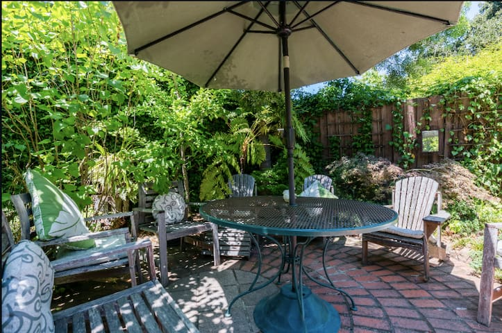 Shady seating in the back garden offers a green oasis - unexpected in the heart of Silicon Valley