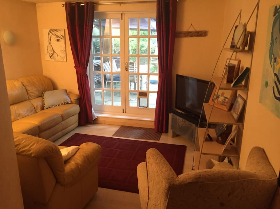 Comfortable TV lounge, adjacent to guests room which guests have full use of.
