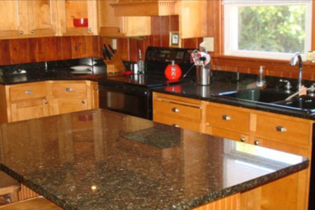 Kitchen with oak cabinets and granite countertops