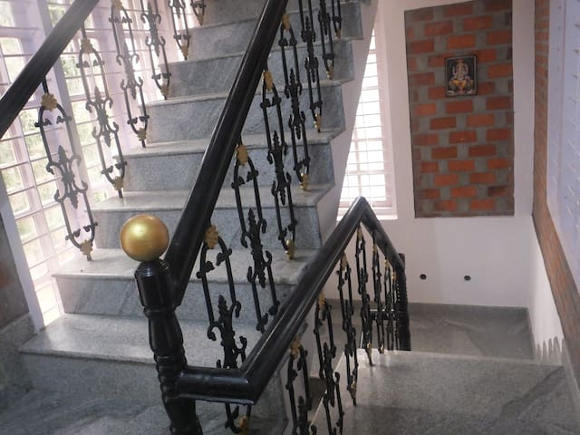 Staircase to the first floor and second floor