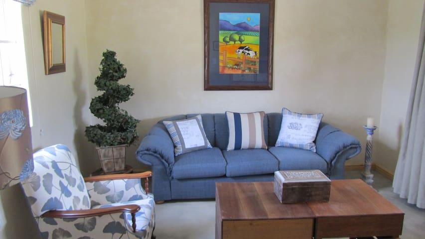 Living room which opens onto entertainment verandah