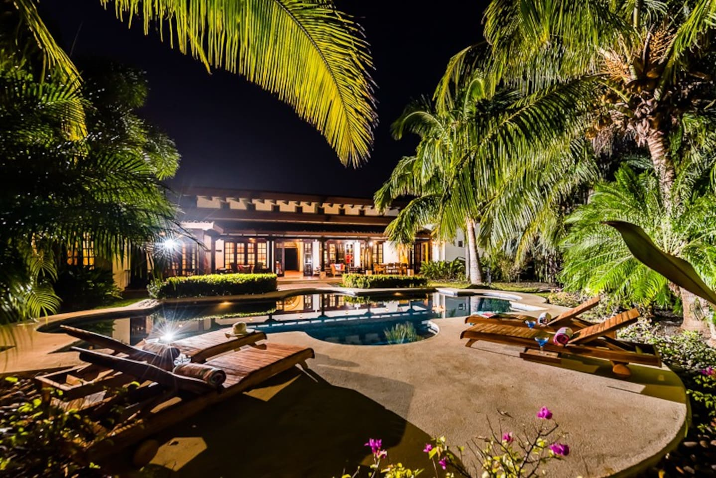 View of the pool and back porch at  night