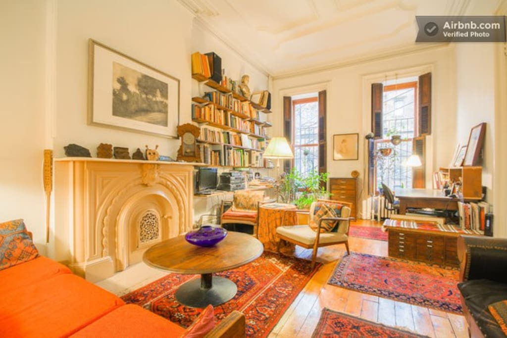 The living room, on the parlor floor,  is spacious and comfortable, has an indoor garden, many books,, records, art work