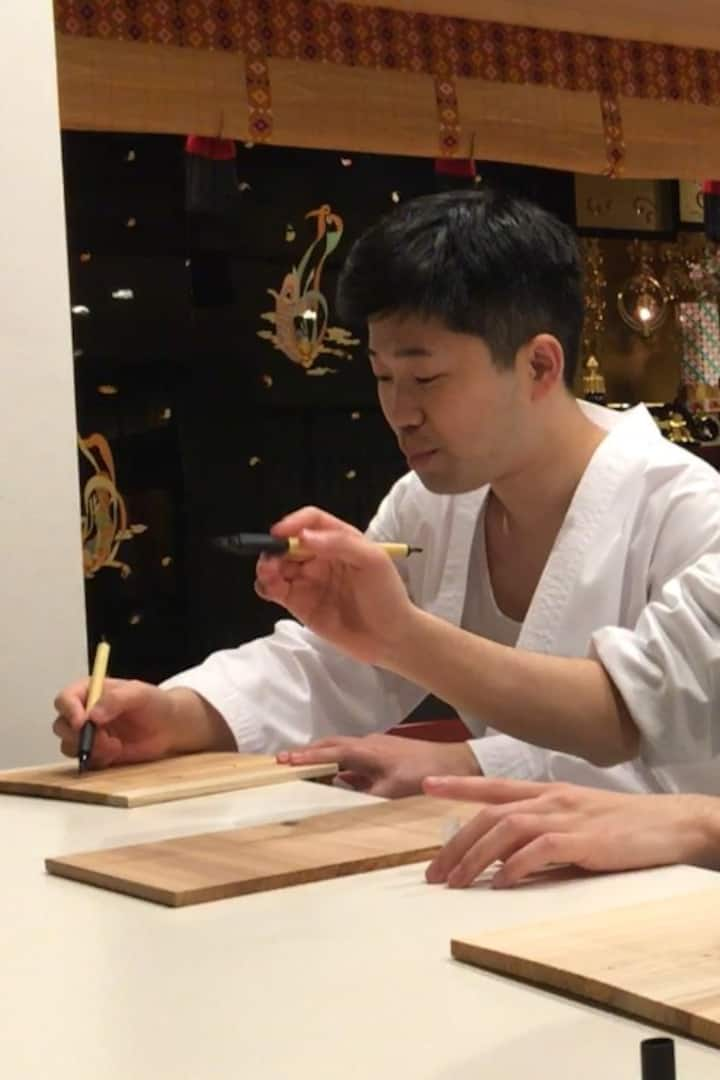 Writing Japanese on  a wooden board