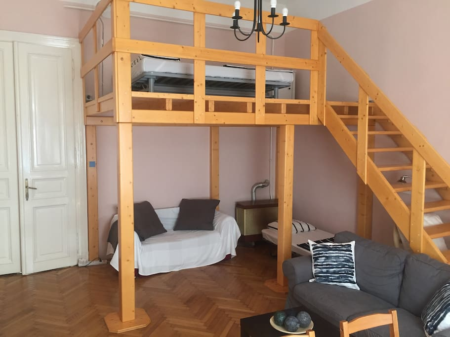 Living room ha s a loft bed (140x200cm), a pull out sofa bed 110x200 cm and an extra foldable bed 90x200 cm. Living room also has a dining table and a second sofa.