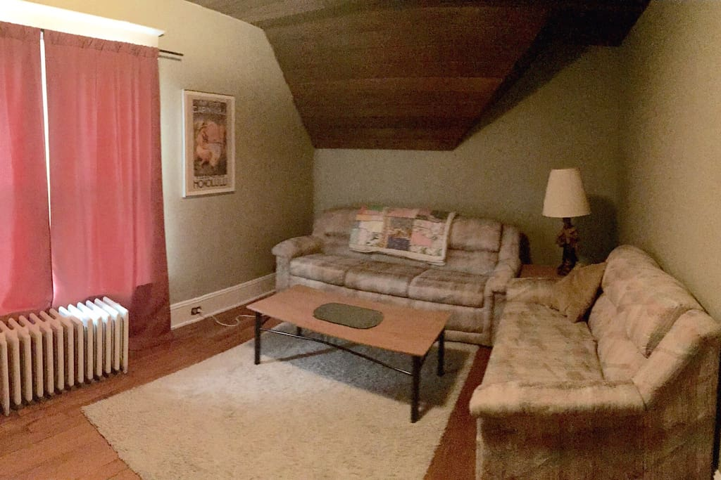 Living room with view of Main Street and pullout couch.