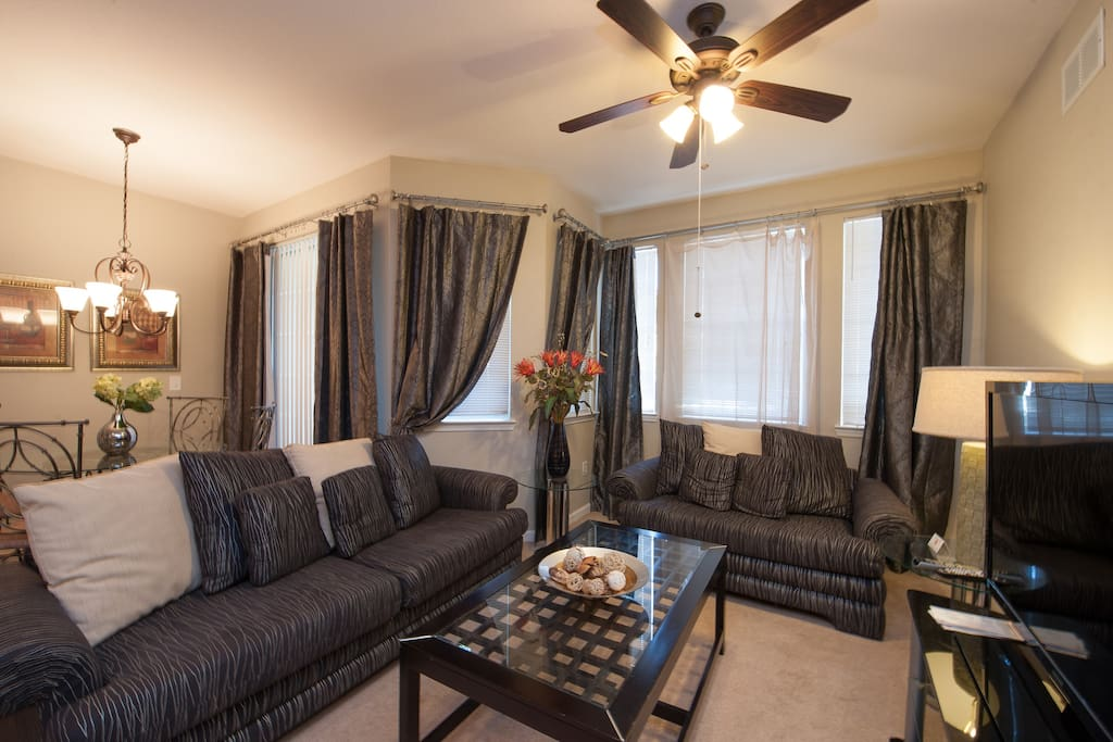 """Living room with 46"""" LED TV and PS3 gaming system"""