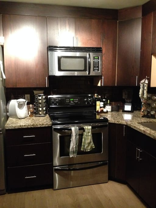 newly renovated kitchen with dishwasher, microwave, blender, and tassimo.