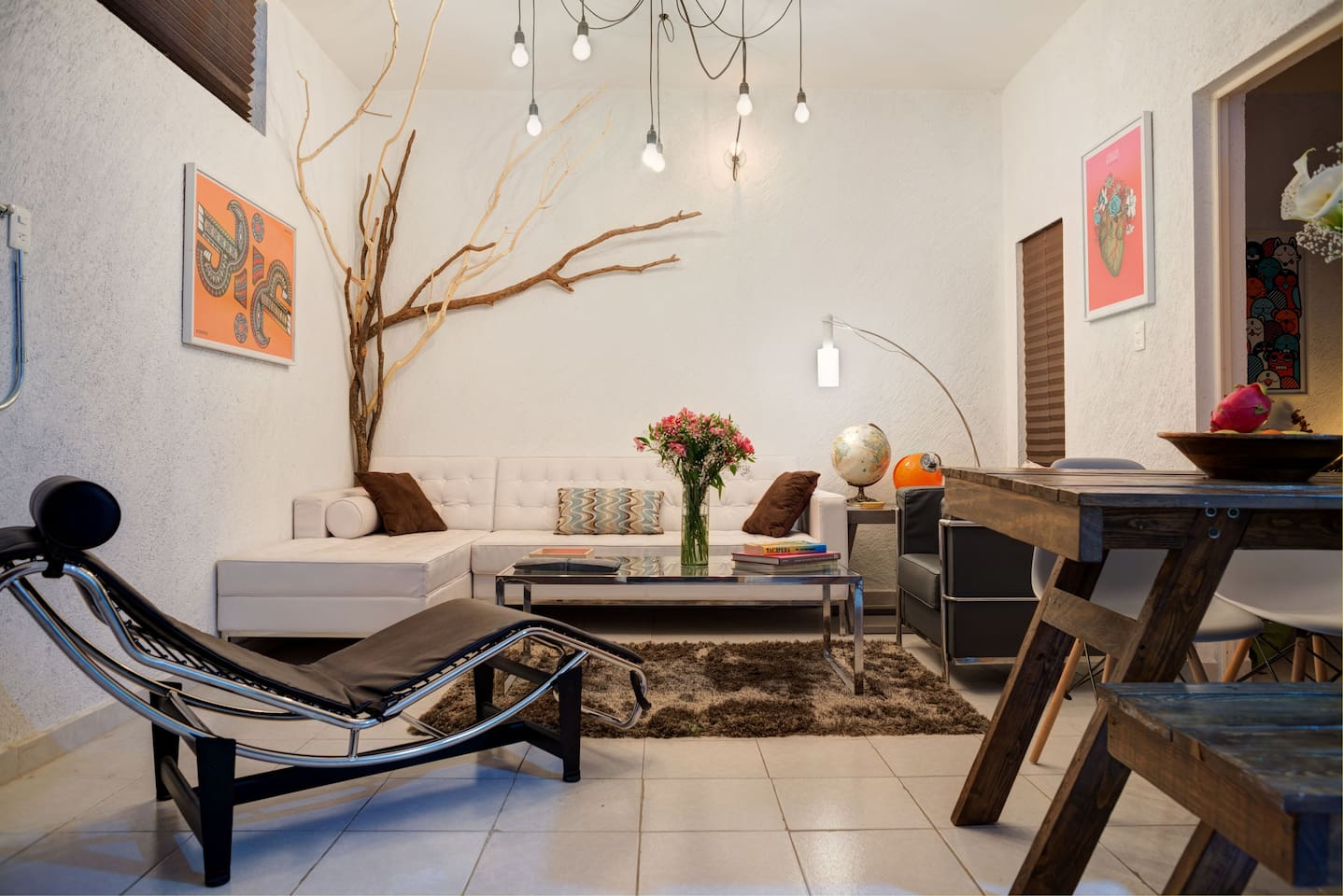 living room, whit designers furniture, decorated whit cool mexican modern illustrations