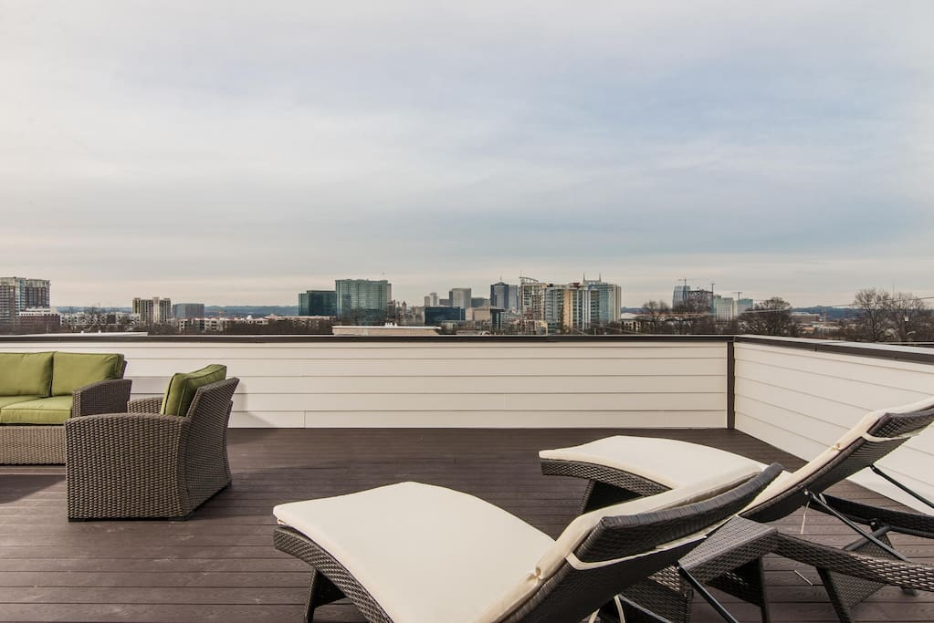 A sprawling, 900 square-foot rooftop deck boasts unobstructed views of the Nashville skyline
