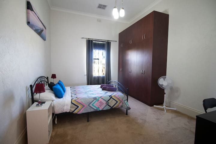 Bedroom 2, queen size bed with ducted heating and cooling.