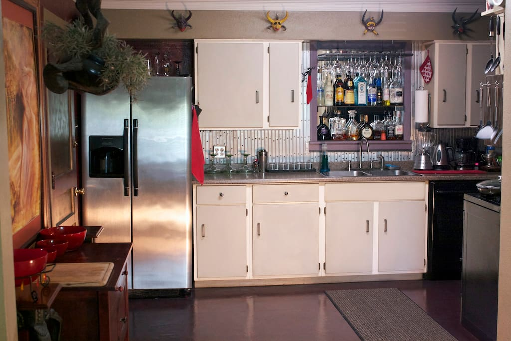 Kitchen: fun and open, with all the amenities, including fridge, microwave, dishwasher, overn, toaster over, etc. The only thing not shared with guests is the bar (well, sometimes:)