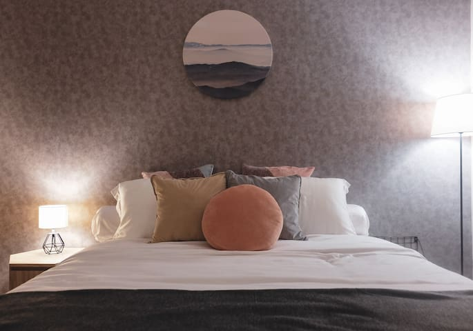 Reading lights for each side of the bed.