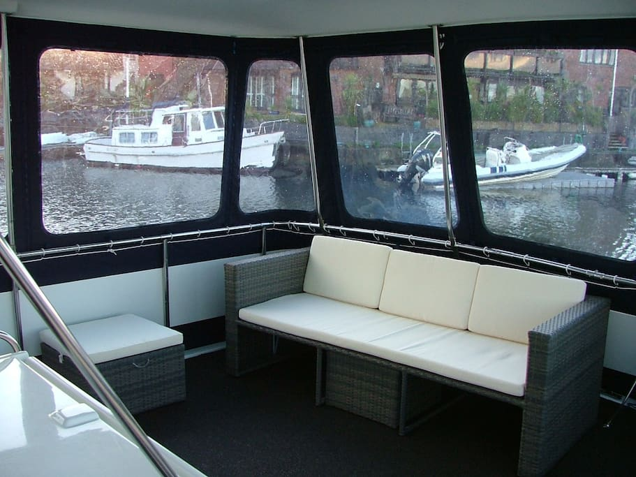 spacious back deck with plenty of seating with optional covers to keep it cosy