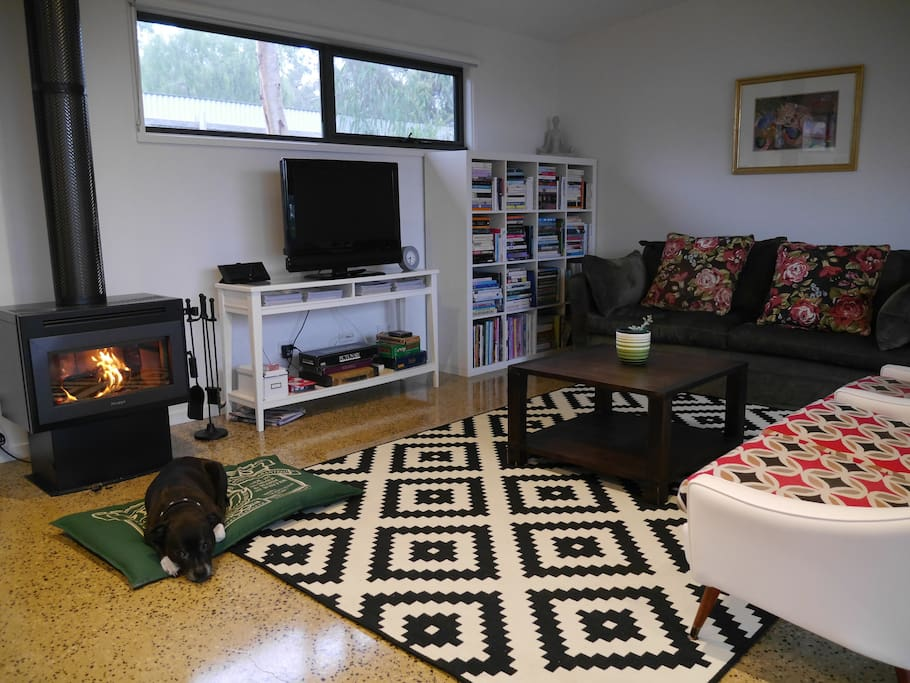 Open plan living and dining room boasts a slow combustion heater which heats the whole house