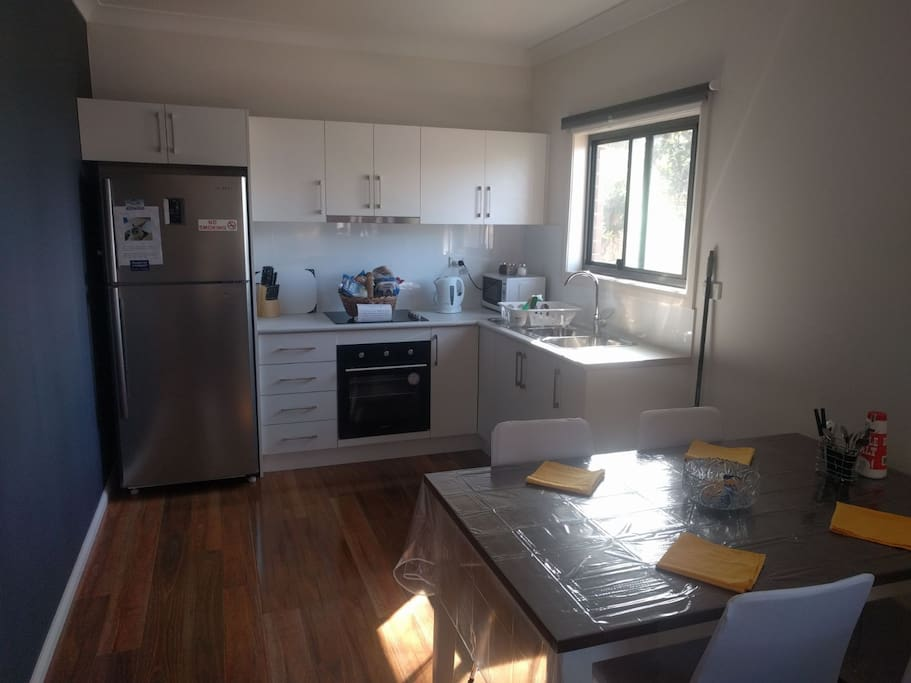 Modern brand new kitchen. Fridge and freezer included. Also included is a electric kettle, electric toaster, microwave, stove and oven. Tea and coffee also included!