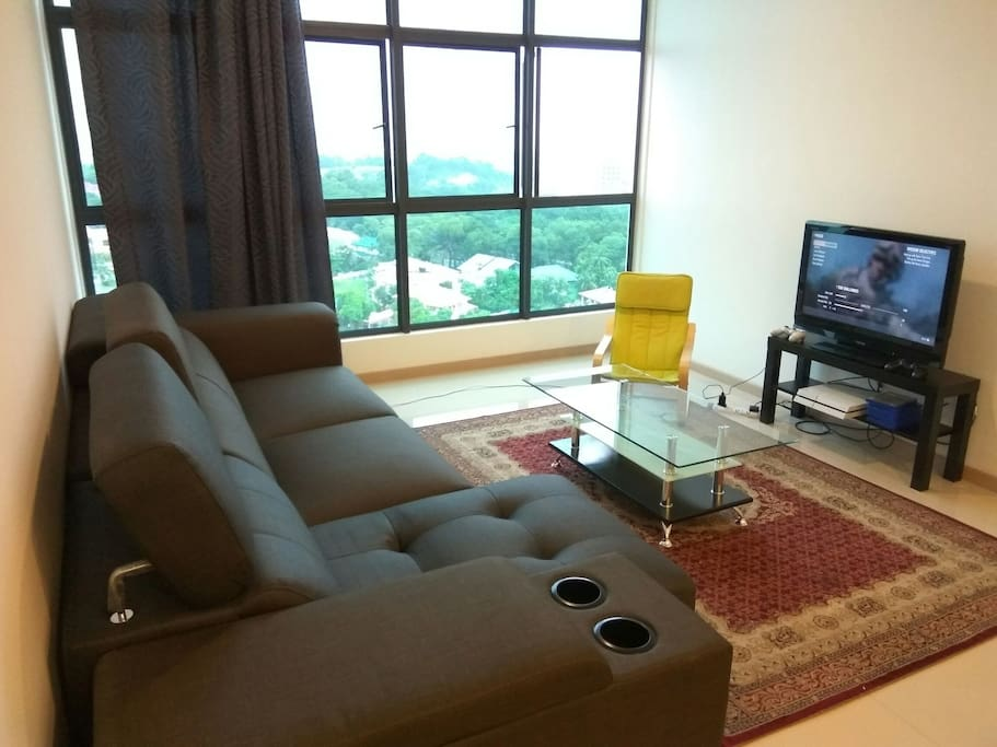 Spacious living room comes with air-conditioning and fans with pull over sofa and a rocking chair. Enjoy our entertainment with , LCD TV and PS 3.