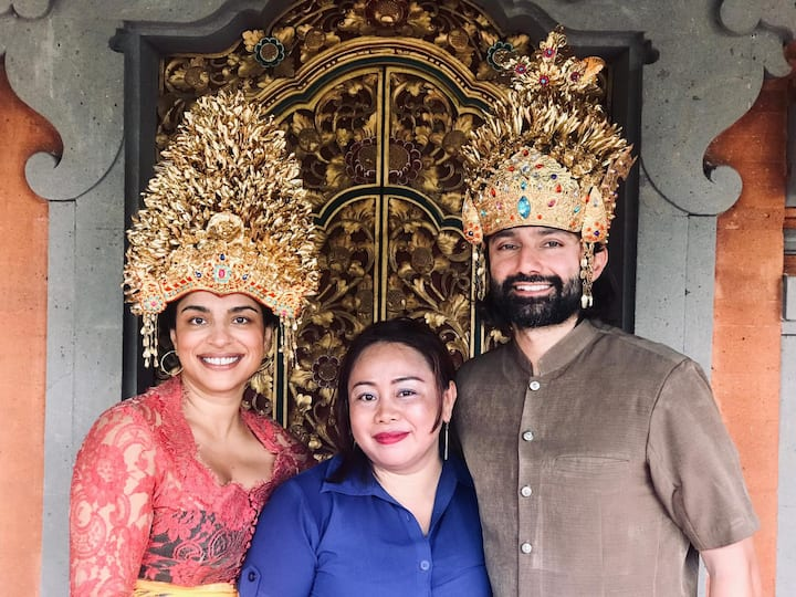Tradisional house and balinese costume