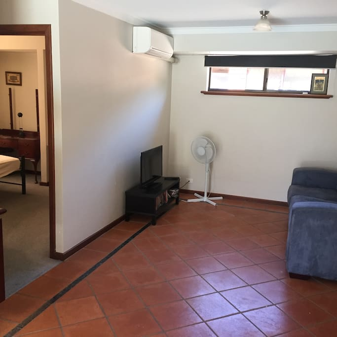 Seperate family room has air con and TV and opens onto pool area