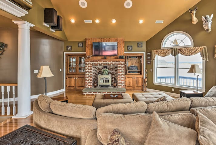 The main home offers a large great room with beach views and wood-burning stove.