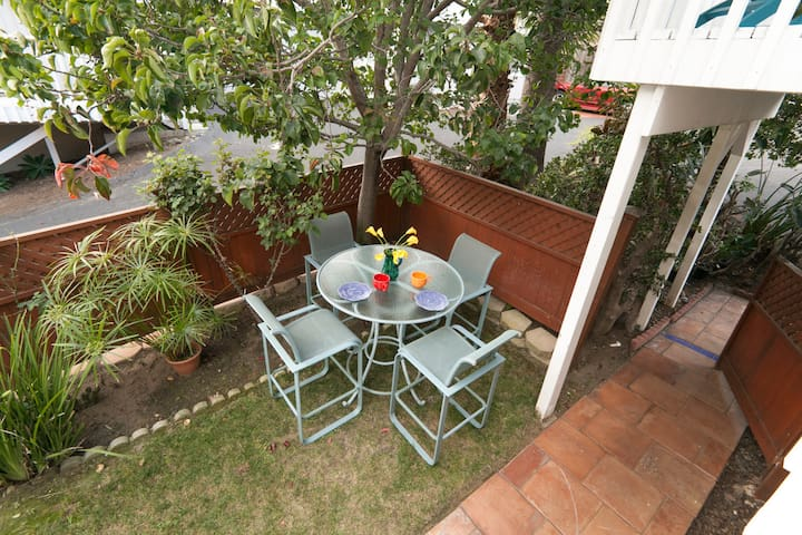 Outdoor dining in private yard.